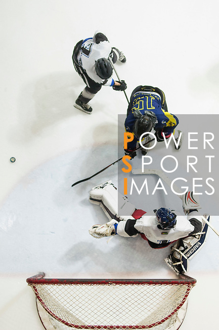 Gaggia Empire Goalkeeper Rex Kong (bottom) defends his goal against Verity Skater #15 Warren Ang (center) with the help of a teammate during the match Gaggia Empire vs Verity, a match part of the Principal Standard League on 07 March 2017 in Mega Ice, Hong Kong, China. Photo by Marcio Rodrigo Machado / Power Sport Images