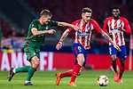 Saul Niguez Esclapez (R) of Atletico de Madrid fights for the ball with Igor Denisov of FC Lokomotiv Moscow during the UEFA Europa League 2017-18 Round of 16 (1st leg) match between Atletico de Madrid and FC Lokomotiv Moscow at Wanda Metropolitano  on March 08 2018 in Madrid, Spain. Photo by Diego Souto / Power Sport Images