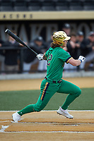 Brooks Coetzee (42) of the Notre Dame Fighting Irish follows through on his swing against the Wake Forest Demon Deacons at David F. Couch Ballpark on March 10, 2019 in  Winston-Salem, North Carolina. The Fighting Irish defeated the Demon Deacons 8-7 in 10 innings in game two of a double-header. (Brian Westerholt/Four Seam Images)