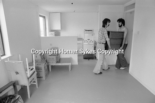Moving house, removal men carrying furniture into a new family home. 1977 Milton Keynes Buckinghamshire 1970s UK