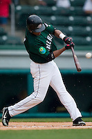 Greenville shortstop Argeniz Diaz (11) makes contact versus West Virginia at West End Field in Greenville, SC, Sunday, July 1, 2007.
