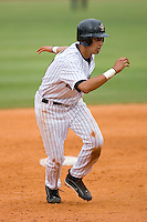 Jiovanni Mier #21 of the Greeneville Astros takes his lead off of second base versus the Danville Braves at Pioneer Park June 28, 2009 in Greeneville, Tennessee. (Photo by Brian Westerholt / Four Seam Images)