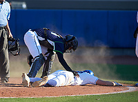 Victory Charter School Knights Lizandro Garcia (21) checks on base runner Quinn Blackman (26) after tagging him out at home during a game against the IMG Academy Ascenders on February 28, 2020 at IMG Academy in Bradenton, Florida.  (Mike Janes/Four Seam Images)