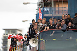 Gary Monk holds the trophy with Swansea City Football Club players and staff celebrating their promotion to the Premier League with an opentop bus tour of the city, where thousands of supporters turned out to show their appreciation..