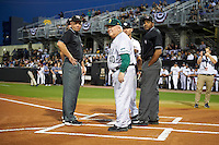 Siena Saints head coach Tony Rossi (40) goes over the ground rules with UCF Knights head coach Greg Lovelady (23) and umpires Damien Beal (right), DJ Breighner (left), and John Bennett (back) on February 17, 2017 at UCF Baseball Complex in Orlando, Florida.  UCF defeated Siena 17-6.  (Mike Janes/Four Seam Images)