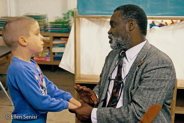 MR / Schenectady, NY.Yates Arts Magnet School / Special Education Class.Principal holds hands with student. (boy, 7, autism, ADHD, epilepsy, multiply handicapped) .MR: Cou3, Ayc2.© Ellen B. Senisi