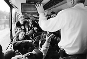 Manchester, New Hampshire.USA.January 27, 2004..Gneral Wesley Clark is interviewed by the press on his press bus  in New Hampshire as he campaigns for the presidency.