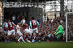 West Ham United 2 Crystal Palace 2, 02/04/2016. Boleyn Ground, Premier League. Home fans in the Bobby Moore Stand watch as their opponents open the scoring at the Boleyn Ground as West Ham United hosted Crystal Palace in a Barclays Premier League match. The Boleyn Ground at Upton Park was the club's home ground from 1904 until the end of the 2015-16 season when they moved into the Olympic Stadium, built for the 2012 London games, at nearby Stratford. The match ended in a 2-2 draw, watched by a near-capacity crowd of 34,857. Photo by Colin McPherson.