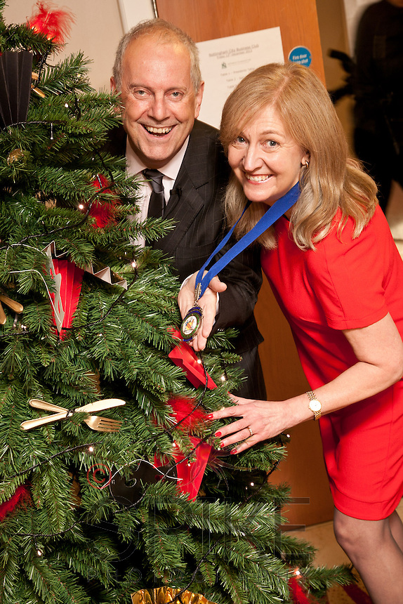 Keynote speaker Gyles Brandreth finds something to hang on the tree with Nottingham City Business CLub President Dianne Allen at the club's Christmas lunch