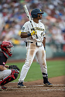 Michigan Wolverines designated hitter Jordan Nwogu (42) at the plate during Game 1 of the NCAA College World Series against the Texas Tech Red Raiders on June 15, 2019 at TD Ameritrade Park in Omaha, Nebraska. Michigan defeated Texas Tech 5-3. (Andrew Woolley/Four Seam Images)