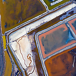 "Pictured: Aerial photographs show colourful salt evaporation ponds and winding natural streams.    Many of the photos, taken of wetlands on the south side of the San Francisco, also feature power lines.   <br /> <br /> Retired photographer Mitch Rouse, who took the photos from his helicopter, said: ""The juxtaposition of the natural streams and waterways below the power lines really draws me into these images.   SEE OUR COPY FOR DETAILS <br /> <br /> Please byline: Mitch Rouse/Solent News<br /> <br /> © Mitch Rouse/Solent News & Photo Agency<br /> UK +44 (0) 2380 458800"