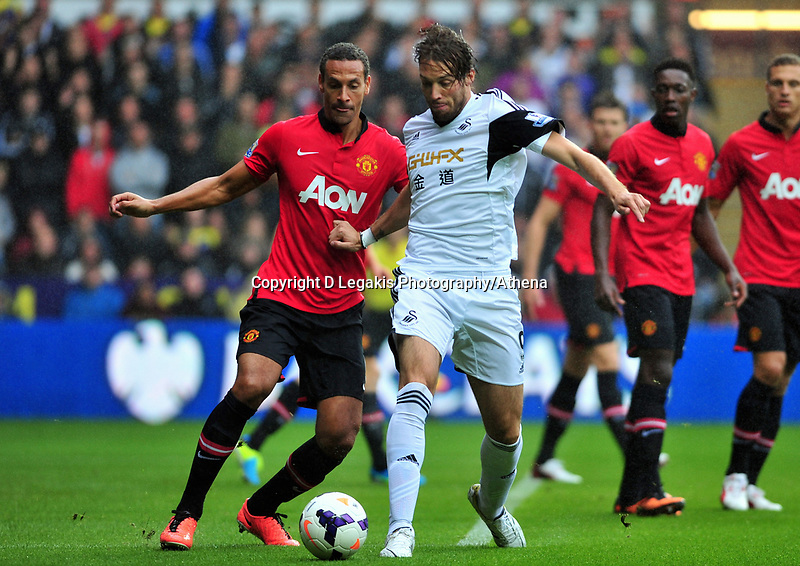 Michu taking on Manchester United's Rio Ferdinand.<br /> Saturday 17 August 2013<br /> Pictured: <br /> Re: Barclays Premier League Swansea City v Manchester United at the Liberty Stadium, Swansea, Wales
