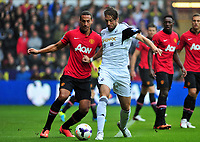 Michu taking on Manchester United's Rio Ferdinand.<br />