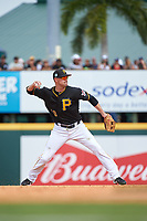 Pittsburgh Pirates shortstop Jordy Mercer (10) throws to first base during a Grapefruit League Spring Training game against the New York Yankees on March 6, 2017 at LECOM Park in Bradenton, Florida.  Pittsburgh defeated New York 13-1.  (Mike Janes/Four Seam Images)