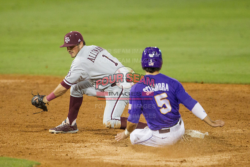 Texas A&M Aggies shortstop Blake Allemand (1) reaches for the ball as LSU baserunner Chris Sciambra (5) slides into second base during a Southeastern Conference baseball game against the LSU Tigers on April 24, 2015 at Alex Box Stadium in Baton Rouge, Louisiana. LSU defeated Texas A&M 9-6. (Andrew Woolley/Four Seam Images)