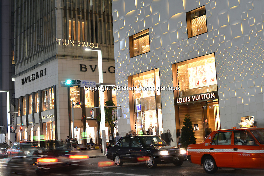 French designer Louis Vuitton next to Italian jewellery maker BVLGARI in the up-market shopping district,  Ginza, Tokyo, Japan.<br /> April-2014