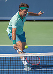 Roger Federer (SUI) wins the first set  against Vasek Pospisil (CAN) at the Western & Southern Open in Mason, OH on August 13, 2014.