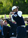 Tiger Woods follows the path of his tee shot during the 2004 Accenture Match Play Championship at La Costa Resort and Spa in Carlsbad, California