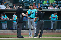 Llamas de Hickory starting pitcher Cole Ragans (31) has his hat and glove checked for any foreign substances by umpire Mitch Leikam (left) and Josh Gilreath (right) between innings of the game against the Winston-Salem Rayados at Truist Stadium on July 6, 2021 in Winston-Salem, North Carolina. (Brian Westerholt/Four Seam Images)