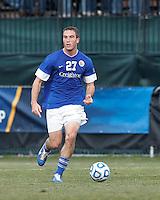 Creighton University defender Brent Kallman (27) looks to pass..NCAA Tournament. Creighton University (blue) defeated University of Connecticut (white), 1-0, at Morrone Stadium at University of Connecticut on December 2, 2012.