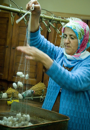A woman extracts silk for carpet weaving in Göreme, Turkey. Rug weaving in Anatolia first began with the arrival of the Turkish tribes from Central Asia, who settled in the region in the 11th century. More than a decoration, carpets have unique stories to tell in their designs, colors, of creation and localities where they are produced. It is tradition that only women weave carpets, while men repair or sell them.