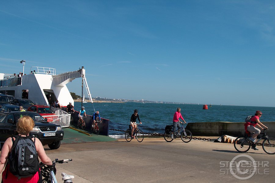 cyclists riding off the Studland Ferry, Poole Harbour ,  Studland, Dorset. , April 2011 pic copyright Steve Behr / Stockfile
