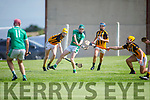 Anthony Cavanagh of Ballyduff been hooked and blocked by Abbeydorney's Oisin Maunsell and TomásÓ hAiniféin in the Minor Hurling Championship semi final.