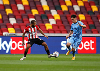 17th October 2020; Brentford Community Stadium, London, England; English Football League Championship Football, Brentford FC versus Coventry City; Bryan Mbeumo of Brentford being challenges by Pontus Jansson of Brentford