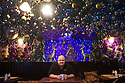 """30/11/15<br /> <br /> Landlord Mark Thomas.<br /> <br /> It has taken a team of five, two weeks to put up this stunning display of Christmas decorations in what is believed to be one of Britain's most festive pubs. The race was on to put up the 7,500 baubles and 27,000 fairy lights, before guests arrived for the pub's first Christmas parties held last night. <br /> <br /> Each of the five rooms at the Hanging Gate at Chapel-en-le-Frith in the Derbyshire Peak District has a different theme or colour. This year the main restaurant is the Indoor Igloo, the bar area is purple and gold and there's the Candy Cain room upstairs in the pub near Buxton. There's also has another 10,000 lights on the outside of the building. <br /> <br /> """"We've had to replace a few thousand of the LED lights this year, I buy them in huge lengths so it's cost lots  to get everything ready"""" said landlord Mark Thomas.<br /> <br /> All Rights Reserved: F Stop Press Ltd. +44(0)1335 418365   www.fstoppress.com."""