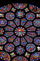 Medieval Rose  Window of the South Transept of the Gothic Cathedral of Chartres, France- Circa 1225-30. A UNESCO World Heritage Site. Dedicated to Christ, who is shown in the central oculus, right hand raised in benediction, surrounded by adoring angels. Two outer rings of twelve circles each contain the 24 Elders of the Apocalypse, crowned and carrying phials and musical instruments. The central lancet beneath the rose shows the Virgin carrying the infant Christ. Either side of this are four lancets showing the four evangelists sitting on the shoulders of four Prophets - a rare literal illustration of the theological principle that the New Testament builds upon the Old Testament. This window was a donation of the Mauclerc family, the Counts of Dreux-Bretagne, who are depicted with their arms in the bases of the lancets