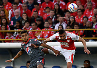 BOGOTA - COLOMBIA - 28 - 01 - 2018: Jose Moya (Der.) jugador de Independiente Santa Fe, salta a disputar el balón con Kevin Ramirez (Izq.) jugador de America de Cali, durante partido entre Independiente Santa Fe y America de Cali, por el Torneo Fox Sports 2018, jugado en el estadio Nemesio Camacho El Campin de la ciudad de Bogota. / Jose Moya (R) player of Independiente Santa Fe jumps to vies for the ball with Kevin Ramirez (L) player of America de Cali, during a match between Independiente Santa Fe y America de Cali, for the Fox Sports Tournament 2018, played at the Nemesio Camacho El Campin stadium in the city of Bogota. Photo: VizzorImage / Luis Ramirez / Staff.