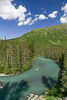 Whitewater rafter floats Bench Creek on the Kenai Peninsula, Alaska