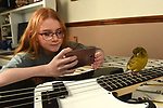 Pictured:  Georgie Shute, 15, with Barry the bird known famously as Barrybirb on social media, with 11k followers are pictured at their home in Swindon.<br /> <br /> A 15 year old girl and her pet canary have become unlikely social media sensations and amassed thousands of followers during lockdown.  Georgie Shute and her 'diva' Gloster Canary Barry first started to gain attention after people noticed the bird's unusual bowl style 'haircut'. <br /> <br /> The schoolgirl said that Barry, who she affectionately refers to as 'Birb', went viral after she snapped a picture of him bathed in rainbow sunlight showing off his plumage.   She posted the picture online and was instantly overwhelmed with messages - and her Instagram account 'barrybirb' now has just under 11,000 followers.   SEE OUR COPY FOR DETAILS.<br /> <br /> © Simon Czapp/Solent News & Photo Agency<br /> UK +44 (0) 2380 458800