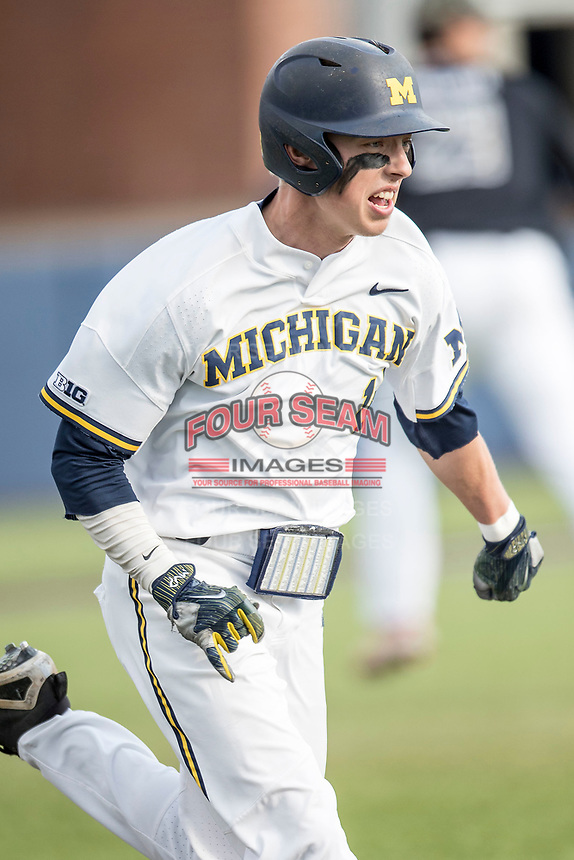 Michigan Wolverines third baseman Blake Nelson (10) runs to first base against the Maryland Terrapins on April 13, 2018 in a Big Ten NCAA baseball game at Ray Fisher Stadium in Ann Arbor, Michigan. Michigan defeated Maryland 10-4. (Andrew Woolley/Four Seam Images)