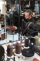 01/05/16<br /> <br /> Phil Ashton uses a ancient sewing machine to stitch a boot together.<br /> <br /> Fuelled by a growing trend for vintage cycling, England's last remaining heavy duty boot-maker, tucked away in the heart of the Derbyshire Peak District, is pedalling a new style of footwear.<br /> <br /> Full story here: http://www.fstoppress.com/articles/vintage-cycle-shoes/<br /> <br />  .For hipster retro-cycling enthusiasts after the authentic vintage look, it's the only English manufacturer of leather shoes designed to work with old-fashioned bike pedal clips.<br /> <br /> For well over a century the family-run firm William Lennon and Co has been hand-making safety boots for the surrounding quarry and lead mining industries.<br /> <br /> And now it is applying the same high level of traditional skill and quality to old-style cycle shoes.<br /> <br /> Located in the small village of Stoney Middleton, the company produces more than 500 pairs of work boots a week and started to make the toe-clip cycle shoes around seven years ago, when the only other manufacturer in Leeds shut down.<br /> <br /> <br /> All Rights Reserved: F Stop Press Ltd. +44(0)1335 418365   www.fstoppress.com.
