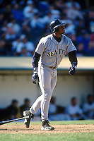 OAKLAND, CA - Ken Griffey Jr. of the Seattle Mariners in action during a game against the Oakland Athletics at the Oakland Coliseum in Oakland, California on September 26, 1996. Photo by Brad Mangin