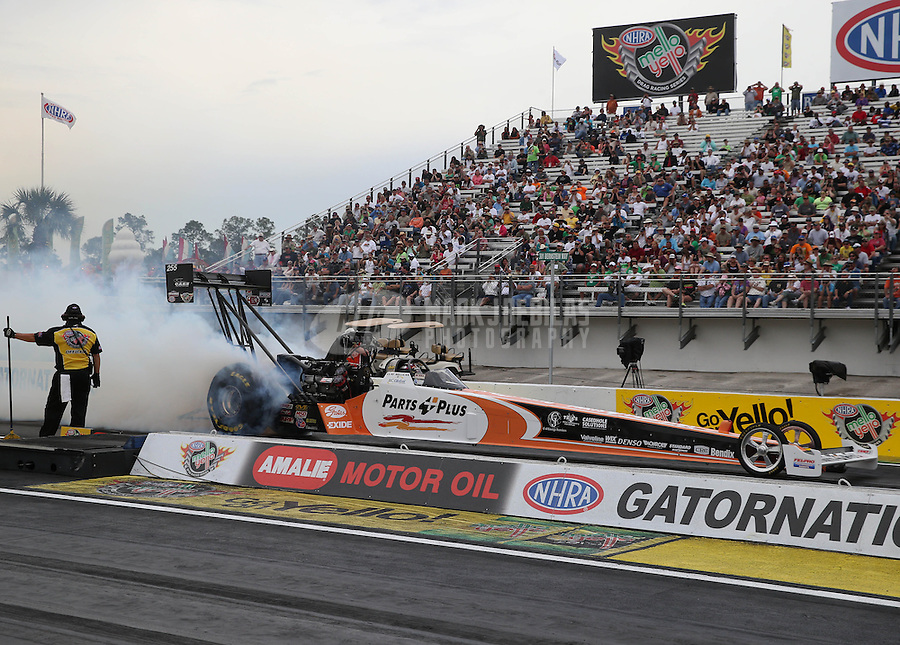 Mar. 17, 2013; Gainesville, FL, USA; NHRA top fuel dragster driver Clay Millican during the Gatornationals at Auto-Plus Raceway at Gainesville. Mandatory Credit: Mark J. Rebilas-