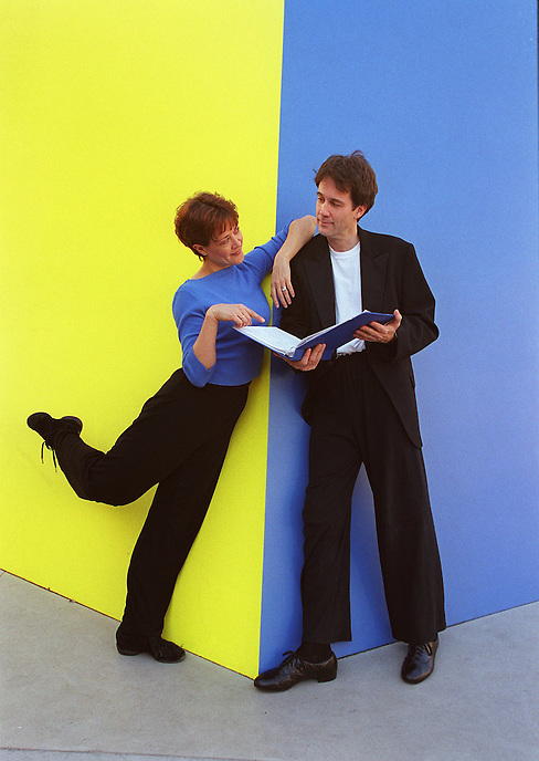 "KAREN ZIEMBA and BOYD GAINES, stars of the ""dance play"", CONTACT, at Lincoln Center Theater at the Mitzi Newhouse, pose near Ellsworth Kelly's YELLOW BLUE sculpture on Lincoln Center Plaza to illustrate the fine line between dance and theater..Lincoln Center, NYC"