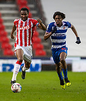 6th February 2021; Bet365 Stadium, Stoke, Staffordshire, England; English Football League Championship Football, Stoke City versus Reading; John Obi Mikel of Stoke City is chased down by Ovie Ejaria of Reading