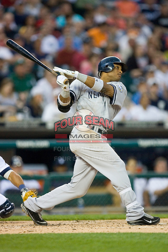 Robinson Cano #24 of the New York Yankees follows through on his swing versus the Detroit Tigers at Comerica Park April 27, 2009 in Detroit, Michigan.  Photo by Brian Westerholt / Four Seam Images