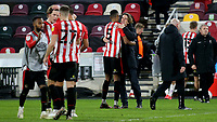 Brentford Manager, Thomas Frank, embraces Ethan Pinnock at the final whistle to celebrate their victory during Brentford vs Bristol City, Sky Bet EFL Championship Football at the Brentford Community Stadium on 3rd February 2021