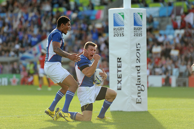 Johan Tromp of Namibia celebrates scoring his team's opening try  during Match 20 of the Rugby World Cup 2015 between Tonga and Namibia - 29/09/2015 - Sandy Park, Exeter<br /> Mandatory Credit: Rob Munro/Stewart Communications