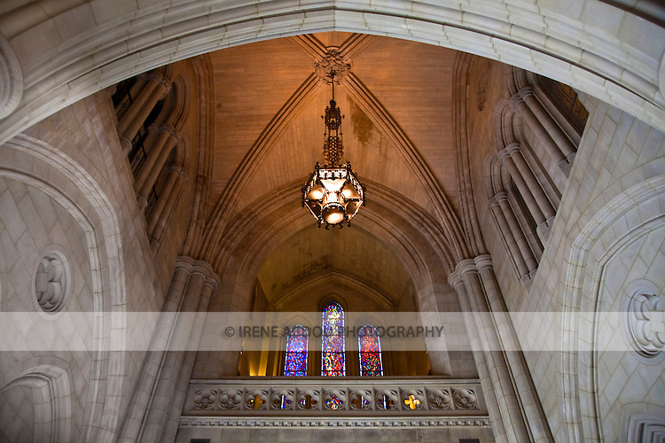 A chandelier hangs above the entrance to the Washington National Cathedral in Washington, DC.  Of neogothic design and architecture, the cathedral is the sixth largest in the world and second largest in the United States.