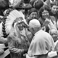 1984 FILE PHOTO - ARCHIVES -<br /> <br /> Chief's welcome, AN Indian chief in full native dress greets the Pope at Ste. Anne de Beaupre yesterday. The chief was one of 4,000 Indian and Inuit people who welcomed the Pontiff to the pilgrimage centre. Some travelled 20 hours for the occasion.<br /> <br /> <br /> 1984<br /> <br /> PHOTO : Boris Spremo - Toronto Star Archives - AQP