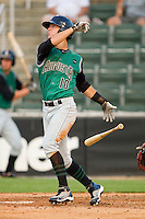 Nick Liles #10 of the Augusta GreenJackets follows through on his swing against the Kannapolis Intimidators at Fieldcrest Cannon Stadium June 24, 2010, in Kannapolis, North Carolina.  Photo by Brian Westerholt / Four Seam Images