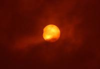 BOGOTÁ - COLOMBIA, 2-07-2019: Eclipse parcial de Sol . /<br /> Partial solar eclipse. Photo: VizzorImage / Felipe Caicedo / Satff