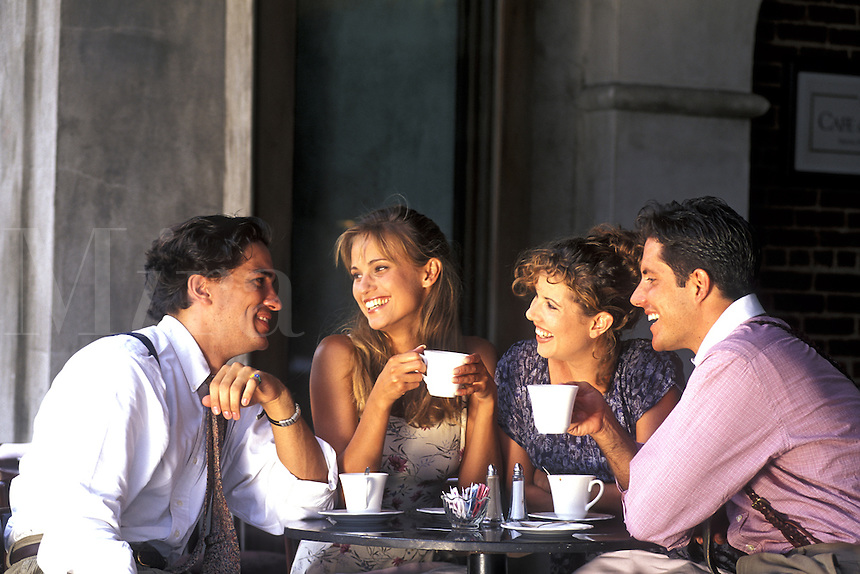 Friends Drinking Coffee at an Outside Cafe