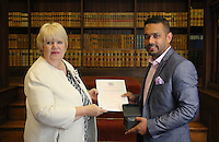 Abdullah Al Mamun (R) receives his certificate at the Citizenship Ceremony at Carmarthen Register Office, Carmarthenshire, Wales, UK. Monday 22 August 2016