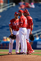 Philadelphia Phillies manager Gabe Kapler (19) stands on the mound with first baseman Austin Listi (76) and catcher Drew Butera (41) as he makes a pitching change during a Grapefruit League Spring Training game against the Baltimore Orioles on February 28, 2019 at Spectrum Field in Clearwater, Florida.  Orioles tied the Phillies 5-5.  (Mike Janes/Four Seam Images)