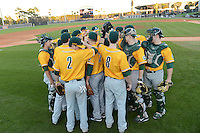 Siena Saints team huddle before warmups before the season opening game against the Central Florida Knights at Jay Bergman Field on February 14, 2014 in Orlando, Florida.  UCF defeated Siena 8-1.  (Mike Janes/Four Seam Images)